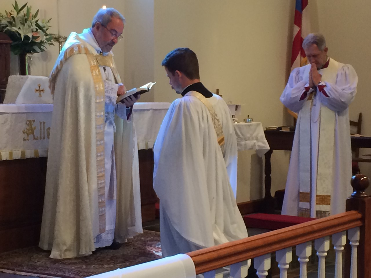 Bp. Grundorf blesses the parish's new curate